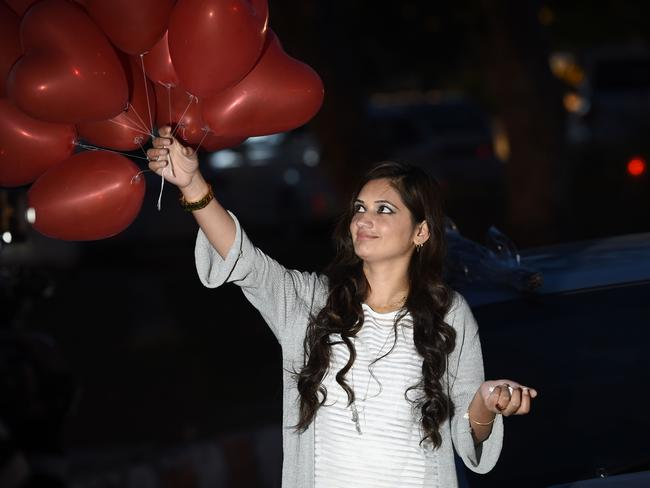 A Pakistani woman carries heart shaped balloons after buying them from the flower market in Islamabad. Picture: AFP