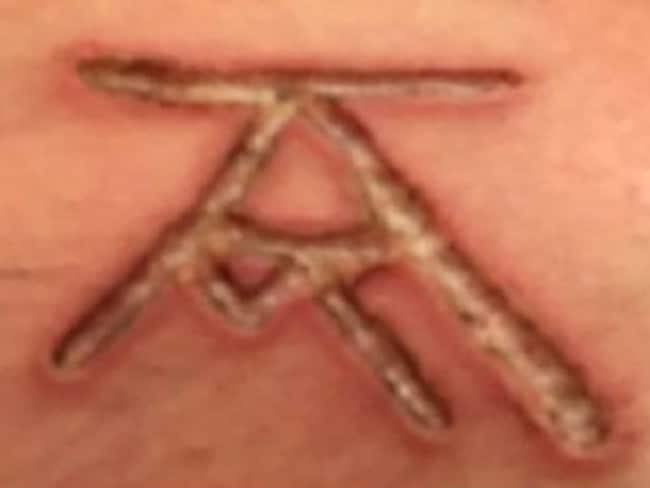 DOS sex slaves were allegedly branded with a symbol combining the initials of Keith Raniere and Allison Mack. Picture: YouTube