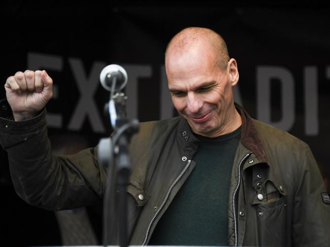 Greek economist Yannis Varoufakis seems a little reluctant to go the full fist pump at the Assange rally. Picture: AP