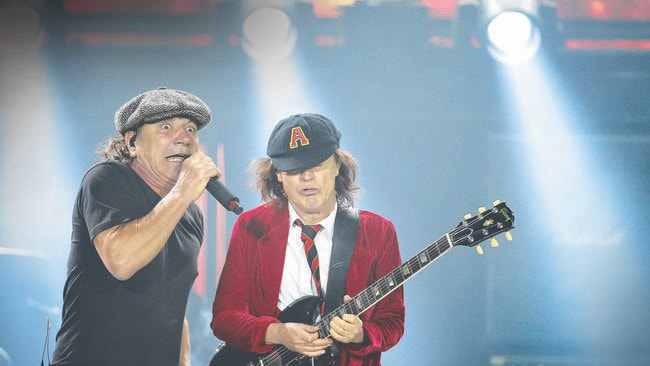 Memories: Brian Johnson with Angus Young on last year's Australian tour. Picture: Dylan Robinson