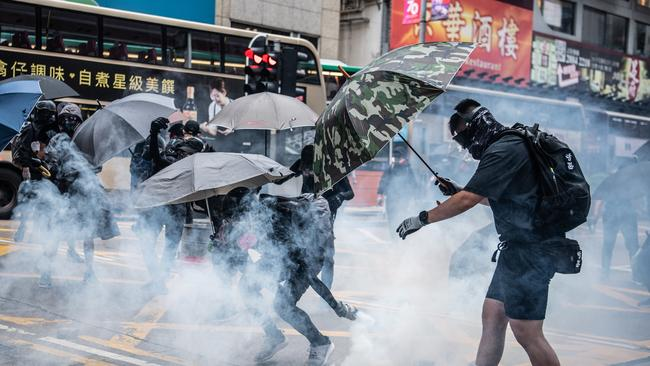 Police fired tear gas and baton-charged the crowds, while some demonstrators threw bricks and petrol bombs at police as night fell.