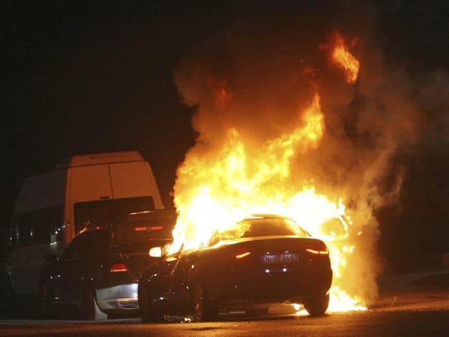 A car burns during a fight between army and police, in Istanbul's Taksim square. Picture: AP Photo/Cavit Ozgul