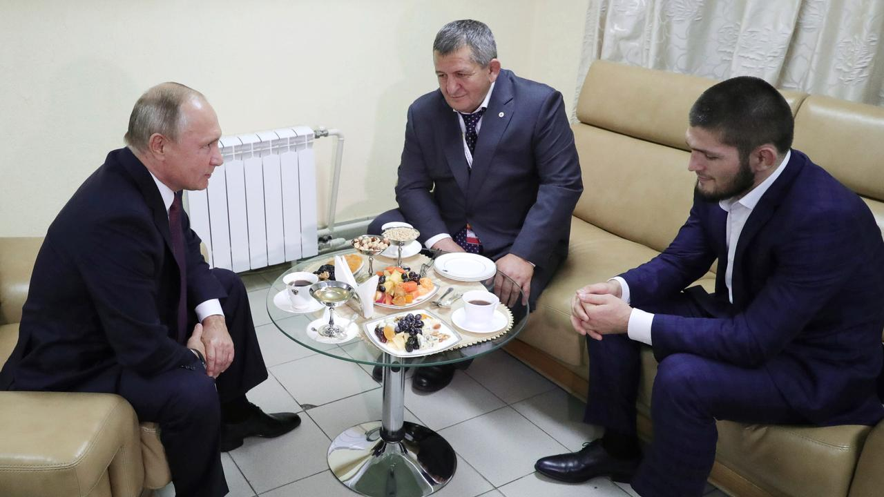 Russian President Vladimir Putin, left, meets with Khabib Nurmagomedov, right, who retained his UFC lightweight title.