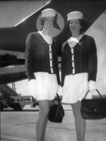 Leigh St Luggage shop proprietor Julie Barnes (l) as a flight attendant at Adelaide Airport in 1972. 1970s air hostess uniform
