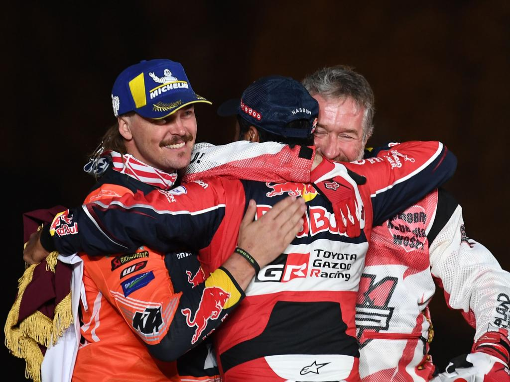 Qatar's car driver Nasser al-Attiyah (C) celebrates on the finishing podium of the Dakar 2020 with Australian motorbike rider Toby Price (L) and Polish Quad rider Rafal Sonik in Qiddiya on January 17, 2020 after the 12th and final stage between Haradh and Qiddiya. (Photo by FRANCK FIFE / AFP) (Photo by FRANCK FIFE/AFP via Getty Images)