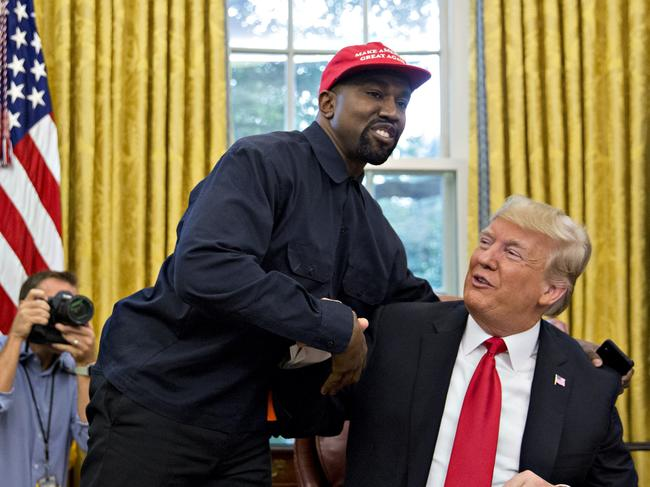 Rapper Kanye West, left, shakes hands with US President Donald Trump during a meeting in the Oval Office of the White House in Washington in 2018. Picture: Getty