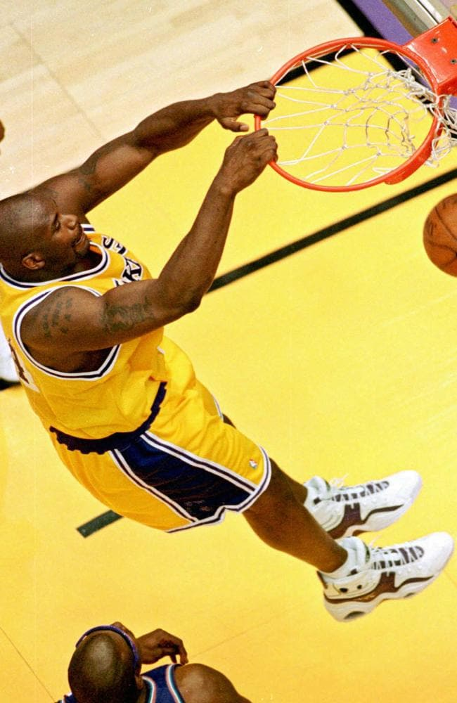Shaq shows off his powerful dunking style against the Utah Jazz.