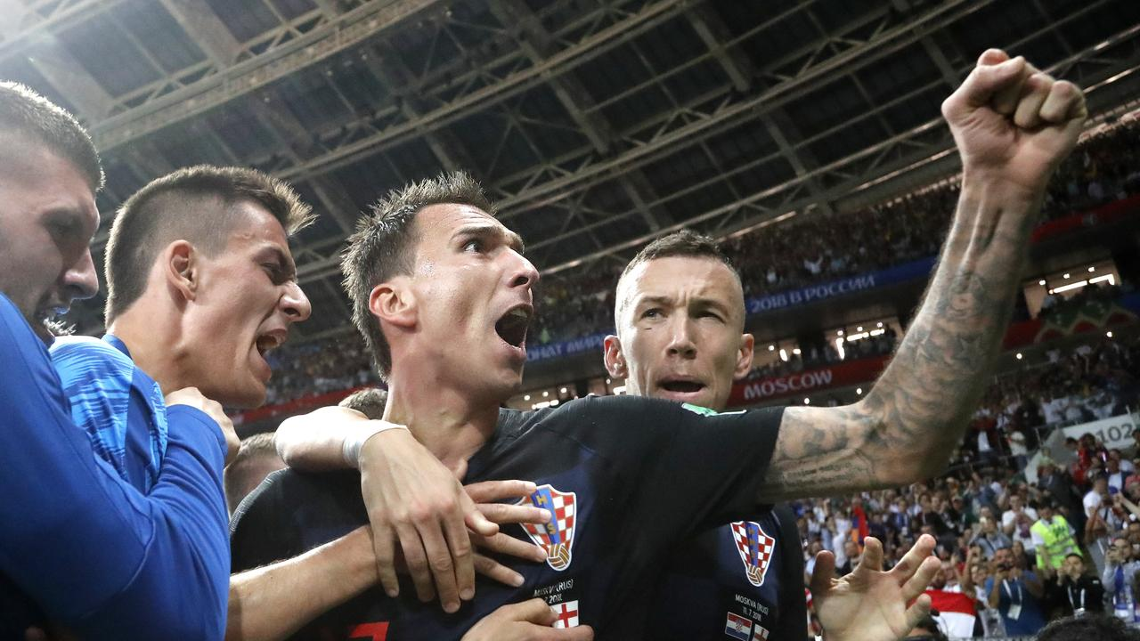 Croatia's Mario Mandzukic, center, celebrates after scoring his side's second goal