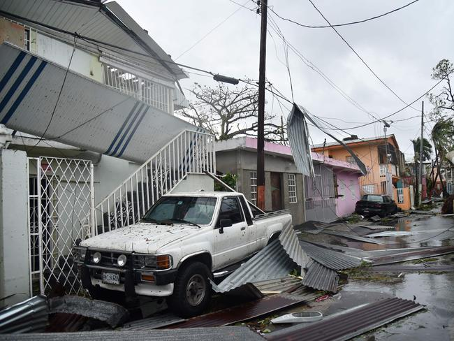 Residents of San Juan, Puerto Rico, deal with damages to their homes. Picture: AFP