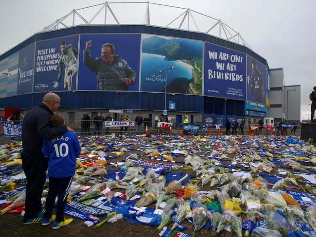 A display of Cardiff City scarfs and jerseys, flowers, messages and other tributes to the football club's new signing Emiliano Sala. Picture: AFP