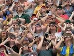 People watch the solar eclipse at Saluki Stadium on the campus of Southern Illinois University on August 21, 2017 in Carbondale, Illinois. Picture: Scott Olson/Getty Images/AFP