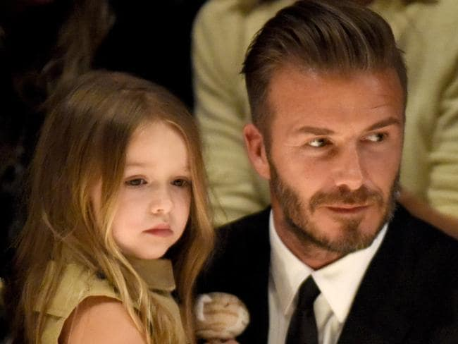 Daddy's little girl ... David Beckham has a close bond with Harper. Picture: Jeff Vespa/Getty Images for Burberry