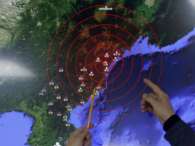 What was felt ... officers from the Korea Meteorological Administration point at the epicentre of seismic waves in North Korea, after it claimed to conduct a powerful hydrogen bomb test. Picture: AP