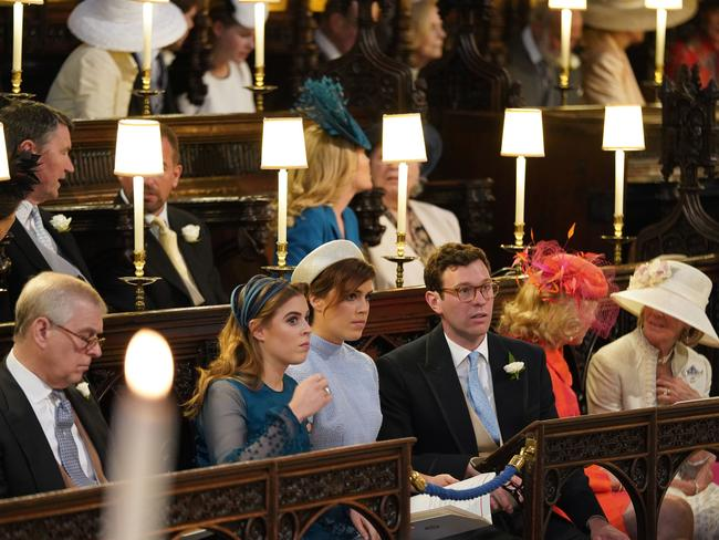 (L-R) The Duke of York, Princess Beatrice, Princess Eugenie and Jack Brooksbank sit ahead of the wedding ceremony of Britain's Prince Harry, Duke of Sussex and US actress Meghan Markle in St George's Chapel, Windsor Castle. Picture: AFP
