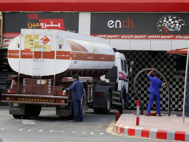 Workers refuel the tank at a petrol station in Jiddah, Saudi Arabia. Saturday's attacks halved oil output in Saudi Arabia, the world's top crude exporter. Picture: AP