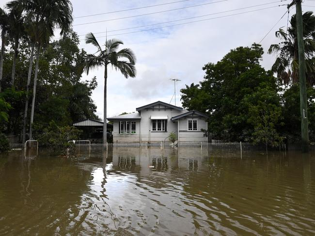 A house is surrounded by flood water in the suburb of Hermit Park in Townsville. Picture: Dan Peled/AAP
