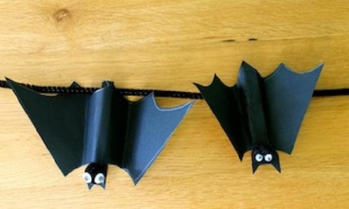 <b>PEG BATS.</b> Your little ones may need a little help sticking all the pieces onto these dark and foreboding peg bats. But that's the best thing about crafting with your kids - getting in there with them. Have a spook-tacular time!