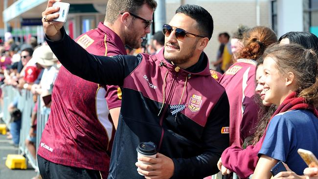 Valentine Holmes gets a selfie with a fan during a Queensland Maroons fan day.