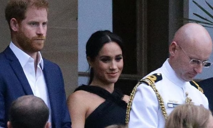 A protective Harry with smiling wife Meghan at an evening reception at Government House.Source:Matrix