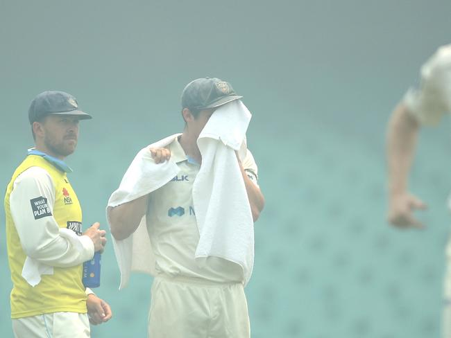 Sean Abbott was wiping smoke as well as sweat out of his eyes.