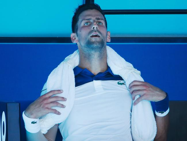 Novak Djokovic tries to cool down between games in his second round match against Gael Monfils. Picture: Scott Barbour/Getty Images