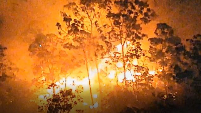 Queensland Police vision of the Lower Beechmont bushfire, captured between 11.45pm Friday and 4am Saturday.