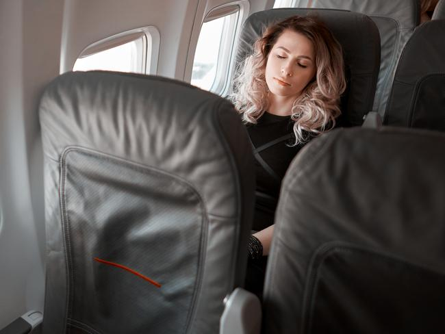 How To Sleep On A Plane Best Position For Reclining Escape