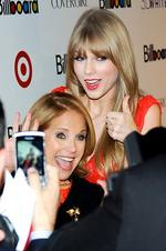 Television journalist Katie Couric, left, and singer Taylor Swift pose together at the 6th annual Billboard Women In Music event at Capitale on Friday, Dec. 2, 2011 in New York. (AP Photo/Evan Agostini)