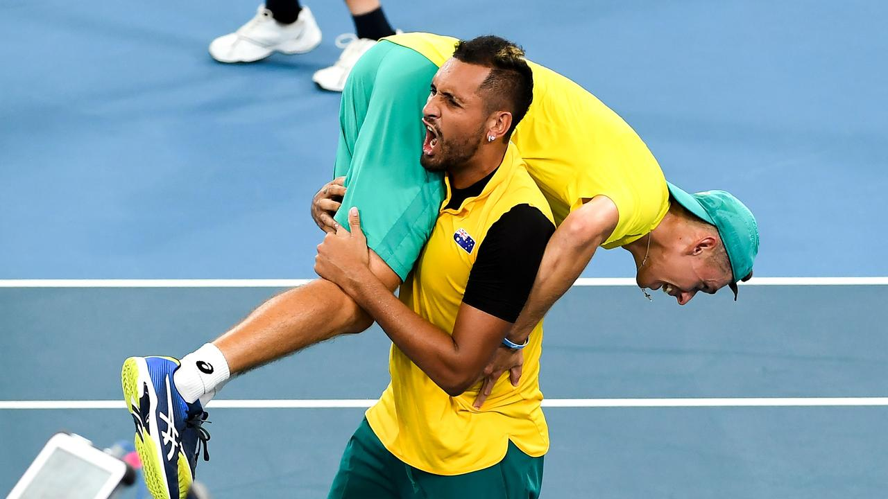 Kyrgios and de Minaur celebrate at the ATP Cup. (Photo by William WEST / AFP)