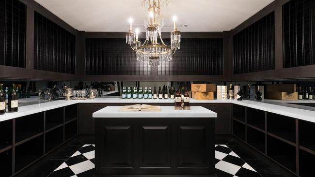 The sleek wine cellar and tasting room is a highlight.