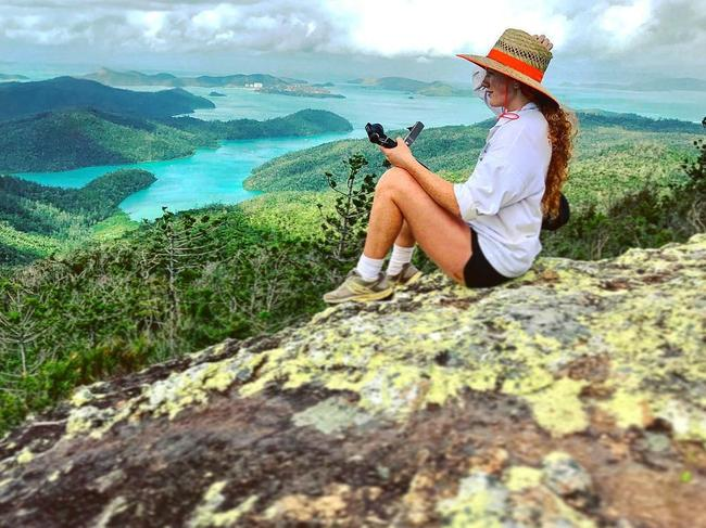 Taking in the view at Whitsunday Peak. Picture: Jam Press