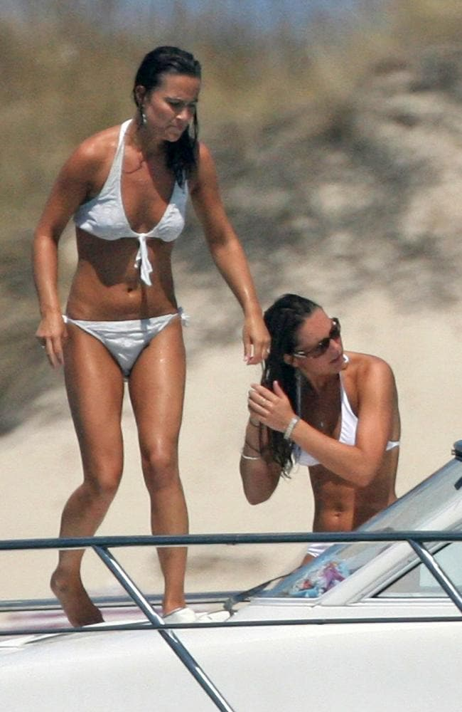 Pippa Middleton is pictured with Kate, on the same day she was briefly photographed topless by paparazzi. Picture: Solarpix/australscope