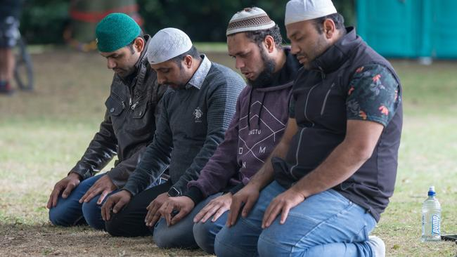 Muslim worshippers pray in Hagley Park near the Al Noor mosque on Deans Rd in Christchurch, New Zealand. Picture: AAP/SNPA, David Alexander.