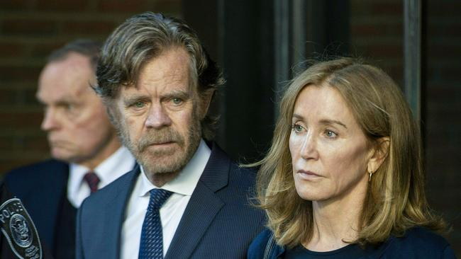 Felicity Huffman with her husband actor William H. Macy leaves the courthouse where she was sentenced for her role in the College Admissions scandal. Picture: Joseph Prezioso/AFP