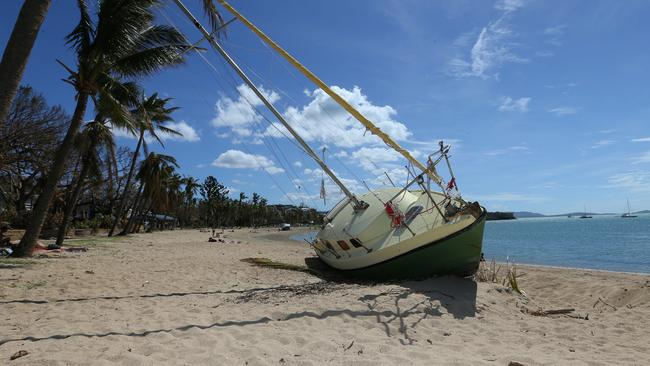 Yacht stranded at Airlie Beach after Cyclone Debbie. Pictures: Jack Tran