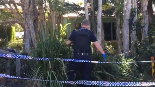 Police search the garden outside Millwell Road Community Centre. Picture: 7 News