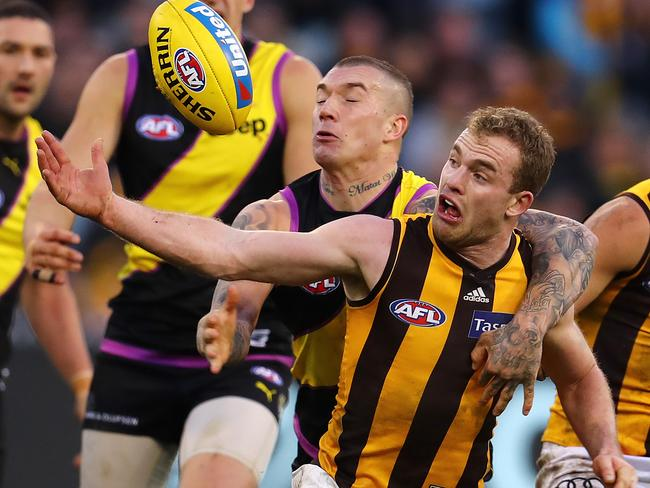 Tom Mitchell is taken high by Dustin Martin. Pic: Michael Klein