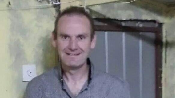 Ashley Phillips, 44, was killed and his body dumped in a wheelie bin.
