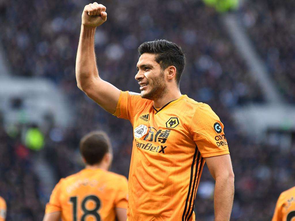 Wolverhampton Wanderers' Mexican striker Raul Jimenez celebrates after scoring their third goal during the English Premier League football match between Tottenham Hotspur and Wolverhampton Wanderers at the Tottenham Hotspur Stadium in London, on March 1, 2020. (Photo by DANIEL LEAL-OLIVAS / AFP) / RESTRICTED TO EDITORIAL USE. No use with unauthorized audio, video, data, fixture lists, club/league logos or 'live' services. Online in-match use limited to 120 images. An additional 40 images may be used in extra time. No video emulation. Social media in-match use limited to 120 images. An additional 40 images may be used in extra time. No use in betting publications, games or single club/league/player publications. /