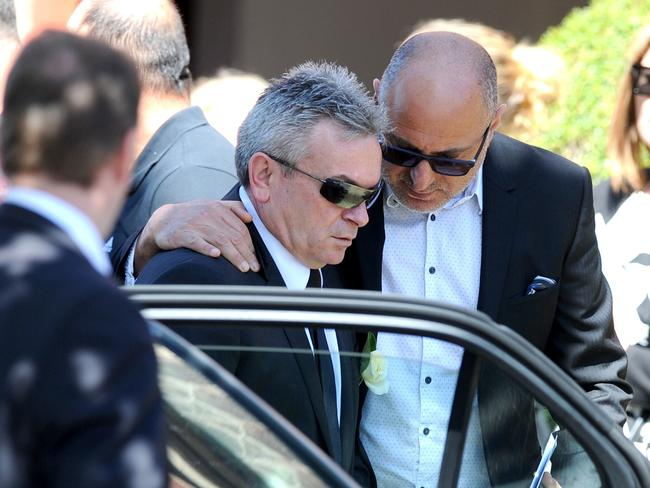 Ristevski is comforted at his wife's funeral. Picture: Joe Castro/AAP