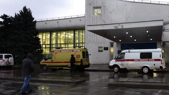 Ambulance cars are parked near the airport building in the city of Rostov-on-Don close to the site of the crash. Picture: AP.