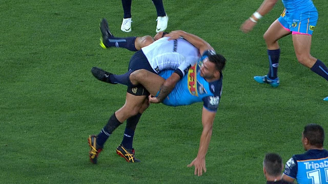 Johnathan Thurston smashes Ryan James.