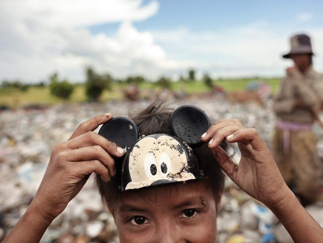 Viku Tupse, 9, poses with a Mickey face, knowing it will please tourists. Picture: David Rengel / AnHua