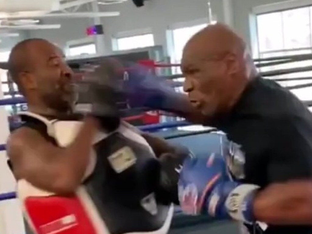 Mike Tyson's trainer Rafael Cordeiro was an inch away from ouch town.