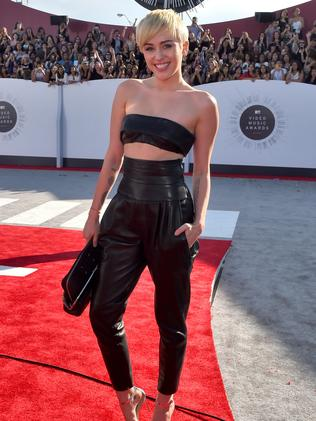 INGLEWOOD, CA - AUGUST 24: Singer Miley Cyrus attends the 2014 MTV Video Music Awards at The Forum on August 24, 2014 in Inglewood, California. (Photo by Larry Busacca/Getty Images for MTV)