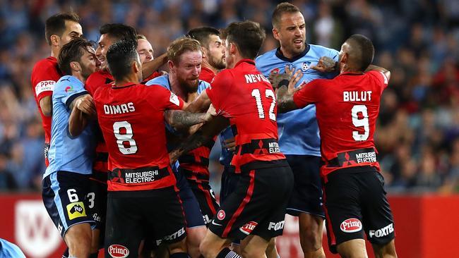 Sydney FC and Western Sydney Wanderers players clash.
