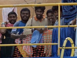 In 2009, Sri Lankan asylum seekers tried to communicate with the media from the deck of the Australian Customs and Immigration Fisheries Patrol vessel anchored off Indonesia's Riau Island of Tanjung Pinang. Picture: AFP/Roslan Rahman