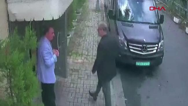 This video grab shows Saudi journalist Jamal Khashoggi (R) arriving at the Saudi Arabian consulate in Istanbul on October 2, 2018.