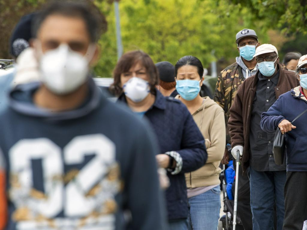 New Yorkers line up for free masks in the borough of Queens. Picture: AP