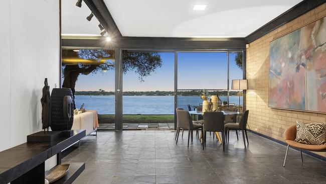 Floor to ceiling windows turn the river into an internal feature.